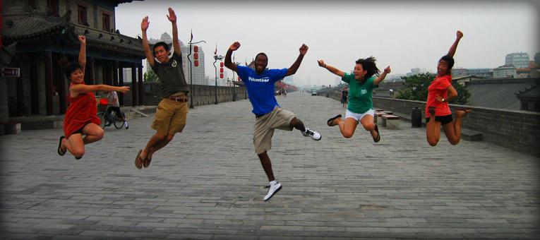 CIEE students jumping for a camera shot in Beijing